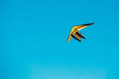 Motorized Hang Glider Flying On Blue Clear Sunny Sky Background.  Stock Photos