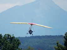 Motorized hang glider on landing. Faicchio, Campania, Italy - 10 June 2018: Engine hang-glider landing in Macchia on the occasion of the first edition of the ` stock image