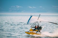 Motorized Hang Glider With Muslim Woman Take Off Frow Sea In Sunny Summer Day. Muslim People Having Fun Stock Image