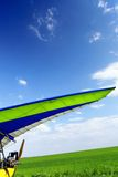 Motorized hang glider over green grass Stock Photography