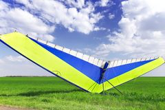 Motorized hang glider over green grass Royalty Free Stock Photo