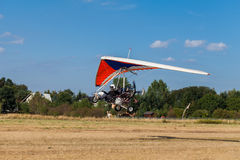 The motorized hang glider over the ground Royalty Free Stock Photography