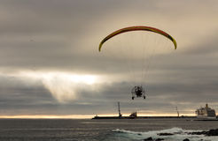 Motorized Paraglider Flight above Ocean Harbor Stock Images