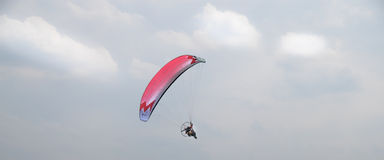 Motorized paraglider flying in the sky Stock Photo