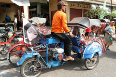 Motorized ricksaw. Motorized rickshaw into transport in rural areas in Sragen, Central Java, Indonesia Stock Photo