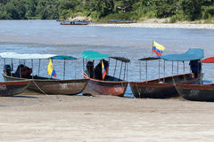 Motorized small boats on the shore of Napo river Ecuador Royalty Free Stock Images