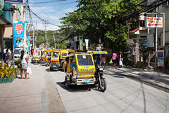 Motorized tricycle. BORACAY, PHILIPPINES - MARCH 04: Tricycle on the street, March 04, 2013, Boracay, Philippines. Motorized tricycles are a common means of Stock Image