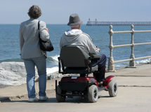 Motorized wheelchair user Royalty Free Stock Photos