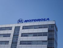 Motorola signage on building exterior. Berlin, Germany - April 2, 2018: Motorola signage on the top of a building. It was an American multinational Royalty Free Stock Photos