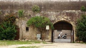 Motoroller in a park. A gray motoroller in a park in Rome. Italy. in summer Stock Photos