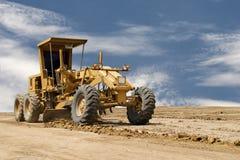 Motorowa równiarka pracuje na budowie drogi Zdjęcie Stock