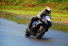 Motorrad-Laufen Stockbild