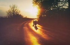 Motorradfahrerreiten Stockfotos