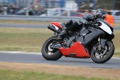 Motorradlaufen Stockbild