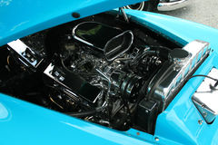 Motors up. Hood up on a blue car so you can see the moter royalty free stock photo