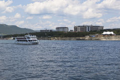 Motorship Salamander sails on the Gelendzhik Bay on the background of Tolstoy Cape Royalty Free Stock Image