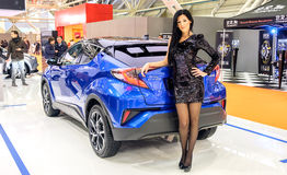 Motorshow girl black hair blue car pantyhose elegant sequin glit Royalty Free Stock Photography