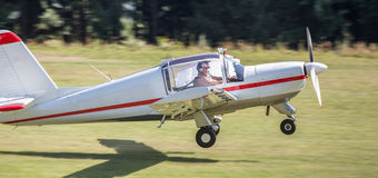 Motorsport airplane. A plain motorsport airplane taking off royalty free stock photos