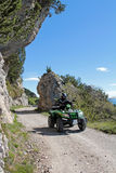 Motorsport - With the ATV in the mountains. Adventurous ride on a mountain pass stock photo