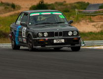 Motorsport BMW E30 320i. Saloon car racing BMW E30 320i  Touring car racing at Hampton Downs motorsport park  classic car meeting January 2012 Royalty Free Stock Photography