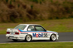 Motorsport BMW E30 Peter Brock Mobil M3. Saloon car racing BMW E30 Mobil Peter Brock M3 Group A Touring car racing at Hampton Downs motorsport park  classic car Royalty Free Stock Photography