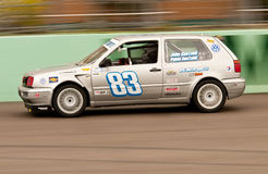 Motorsports car accelerates Royalty Free Stock Photography