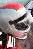 Motorsports emballant le casque Photographie stock libre de droits