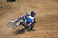 Motorsports mx rider turning falls royalty free stock images