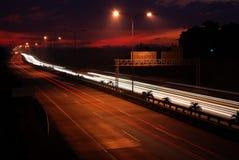 motorvägsolnedgång Fotografering för Bildbyråer