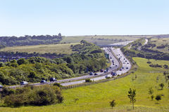 Motorway. A busy motorway cutting through the green fields of the South Downs stock images