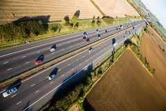Motorway from the air. Aerial view of cars speeding along a motorway in rural Somerset, England royalty free stock photo
