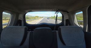 Motorway from the back of the car. View of motorway from the back of the car royalty free stock photography