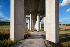 Motorway bridge. Landscape, concrete girder piers for superhighway royalty free stock image