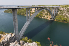 Motorway bridge over the Krka river near Sibenik, Croatia. Concrete modern high motorway arch bridge over the wide river Stock Photography