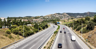 Motorway with cars circling. In the Spanish province of Barcelona with the mountains of Alella in the background. It is an editorial image on a sunny day royalty free stock photos