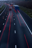 Motorway at dusk. With traffic of trucks and light trails stock images