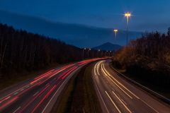 Motorway at Dusk with Car Lights royalty free stock images