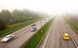Motorway in fog Stock Images