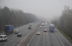 Motorway in Fog. Traffic in foggy conditions on the M3 Motorway near Fleet ,Hampshire , England royalty free stock image