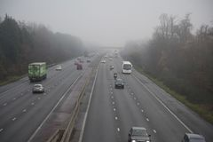 Motorway in Fog. Traffic in foggy conditions on the M3 Motorway near Fleet ,Hampshire , England stock photo