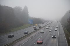 Motorway in Fog. Traffic in foggy conditions on the M3 Motorway near Fleet ,Hampshire , England stock photos