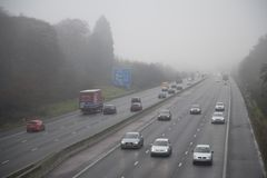 Motorway in Fog. Traffic in foggy conditions on the M3 Motorway near Fleet ,Hampshire , England royalty free stock photography