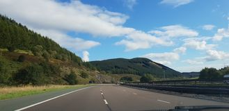 Motorway highlands UK scotland England border drive. Motorway drive scenic blue skies royalty free stock photography