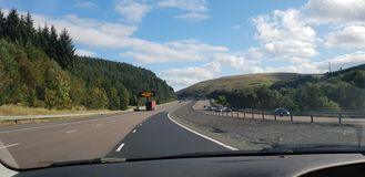 Motorway highlands UK scotland England border drive. Motorway drive scenic blue skies stock image