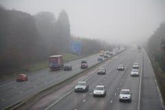Motorway i dimma royaltyfri fotografi