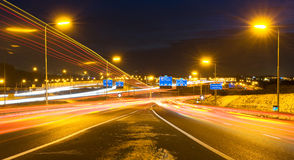 Motorway intersection. A snowy and icy motorway intersection on a winter night Stock Images