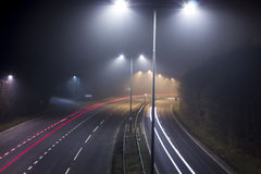 Motorway Long Exposure. A Motorway (or highway) long exposure at night while foggy Royalty Free Stock Photo