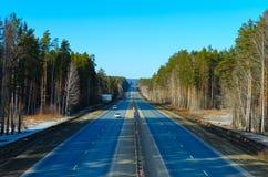 Motorway M-5 from Chelyabinsk to Ekaterinburg. The M-5 motorway leaving for the horizon from Chelyabinsk to Yekaterinburg. View from elevation, April 2019 m5 stock images