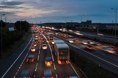 Motorway M1 på skymning royaltyfri foto