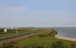 Motorway in the middle of a dam in Netherlands. Motorway in the middle of the immense dam in North of the Netherlands Royalty Free Stock Photography